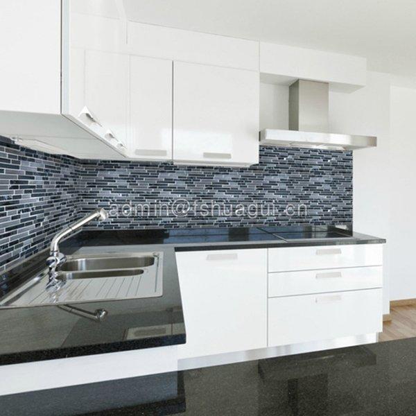 Black kitchen mosaic backsplash
