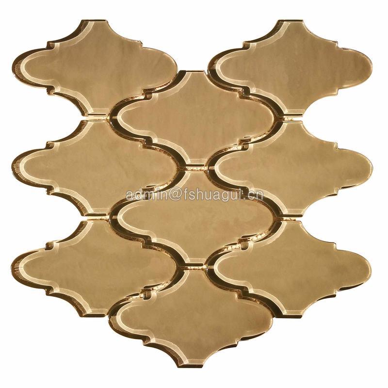Golden water jet glass lantern mosaic backsplash