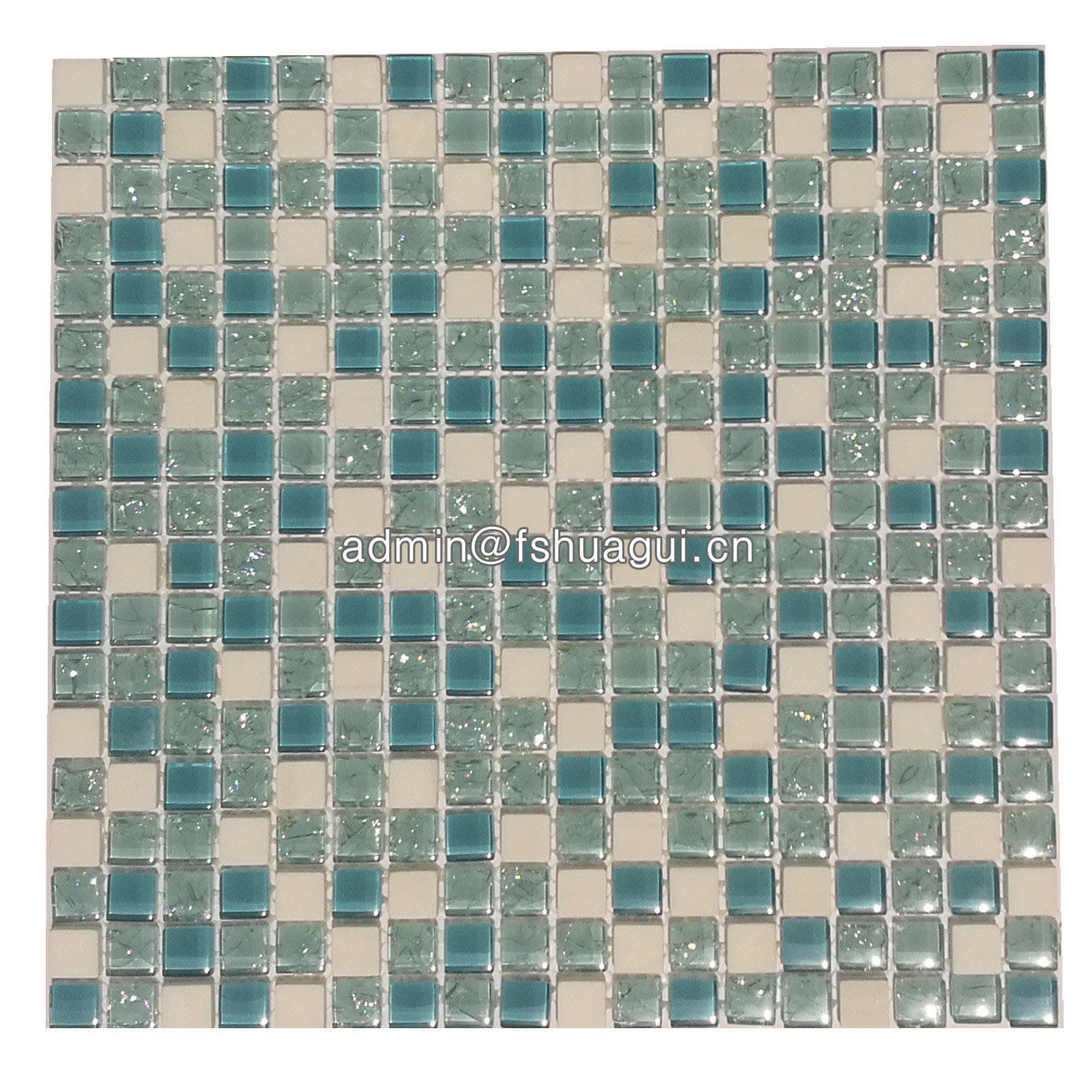 Tiffany blue crackle glass and white stone mosaic tile over cooktop
