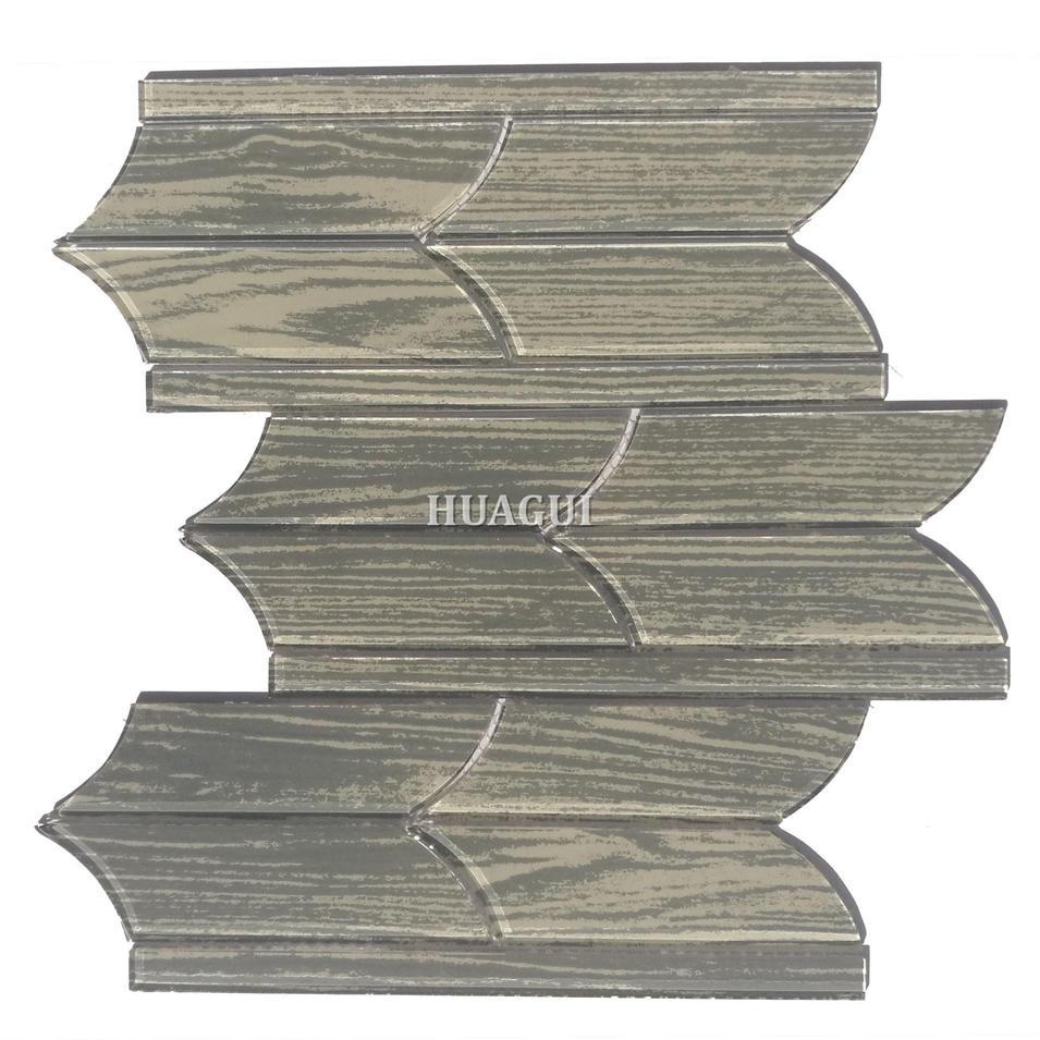 Polished tile of irregular grey glass mosaic backsplash